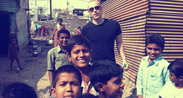 Lee with the children in India